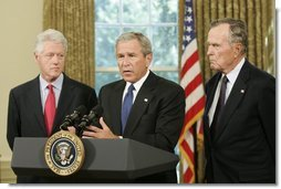 "Standing with former Presidents Bill Clinton and George H. W. Bush, President George W. Bush discusses the plans to help people affected by Hurricane Katrina in the Oval Office Sept. 1, 2005. ""We're working hard to repair the breaches in the levees. Federal, state, and local agencies are also cooperating to sustain life,"" President Bush. ""That means getting food and water to those who are stranded. Medical personnel and local officials are helping hospital patients and people gathered in the Superdome to evacuate.""  White House photo by Paul Morse"