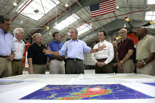 President George W. Bush talks about Hurricane Katrina disaster relief with, from left: Senator Trent Lott, R-Miss.; Senator Thad Cochran, R-Miss.; Mississippi Governor Haley Barbour; Alabama Governor Bob Riley; FEMA Director Mike Brown; Michael Chertoff, Secretary of Homeland Security, and Alphonso Jackson, Secretary of Housing and Urban Development. The President briefed the officials during his tour Friday, Sept. 2, 2005, of the Gulf Coast regions hard hit by the storm. White House photo by Eric Draper