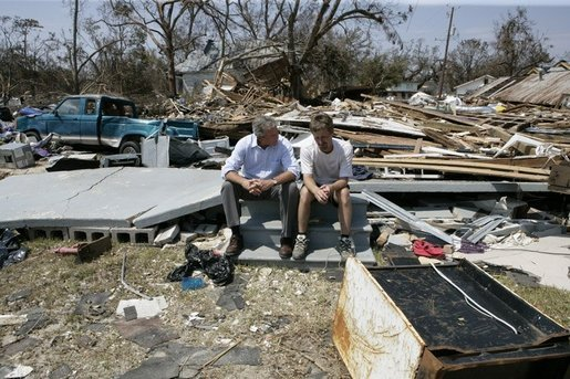 "President George W. Bush spends a moment with a Patrick Wright during his walking tour Friday, Sept. 2, 2005, of Biloxi, Miss. ""You know, there's a lot of sadness, of course,"" said the President of the devastated area. ""But there's also a spirit here in Mississippi that is uplifting."" White House photo by Eric Draper"