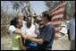 "President George W. Bush embraces victims of Hurricane Katrina Friday, Sept. 2, 2005, during his tour of the Biloxi, Miss., area. "" The President told residents that he had come down to look at the damage first hand and to tell the ""good people of this part of the world that the federal government is going to help."" White House photo by Eric Draper"