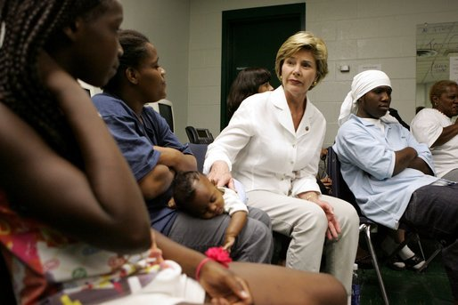Laura Bush visits with people affected by Hurricane Katrina in the Cajundome at the University of Louisiana in Lafayette, La., Friday, Sept. 2, 2005. White House photo by Krisanne Johnson
