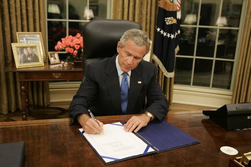 george bush oval office. President George W. Bush Signs Legislation In The Oval Office Friday, Sept. 2