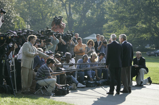 President George W. Bush and Michael Chertoff, Secretary of Homeland Security, talk with the media Friday, Sept. 2, 2005, on the South Lawn of the White House. The President briefed the press on hurricane disaster relief before departing for a tour of the Gulf Coast area hit by Hurricane Katrina. White House photo by Paul Morse