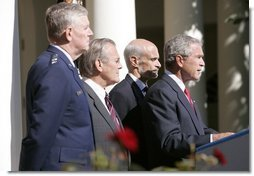 President George W. Bush speaks to the nation during a weekly radio address, live from the Rose Garden at the White House in Washington, D.C., September 3, 2005. Accompanying the president are (L to R) Chairman of the Joint Chiefs of Staff, General Richard Myers, Secretary of Defense Donald Rumsfeld and Homeland Secretary Michael Chertoff.  White House photo by Paul Morse