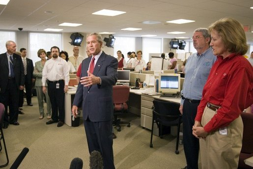 President George W. Bush addresses the press during a visit of the Red Cross in Washington, D.C. on Sunday September 4, 2005. The President and Mrs. Laura Bush visited Red Cross headquarters to view relief efforts in the aftermath of hurricane Katrina. White House photo by Paul Morse