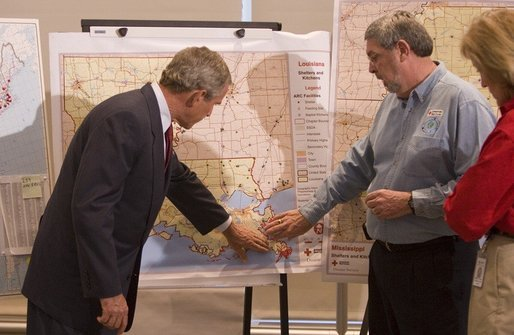President George W. Bush gets a briefing on the efforts of the Red Cross in the aftermath of hurricane Katrina at Red Cross headquarters in Washington, D.C. on Sunday September 4, 2005. White House photo by Paul Morse