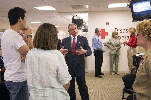 President George W. Bush talks with employees and volunteers during a visit of the Red Cross in Washington, D.C. on Sunday September 4, 2005. The President and Mrs. Laura Bush visited Red Cross headquarters to view relief efforts in the aftermath of hurricane Katrina. White House photo by Paul Morse