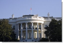 The United States flag flies at half-staff in honor of the death of Supreme Court Justice William Rehnquist, and as a mark of respect for the victims of Hurricane Katrina. White House photo by Paul Morse