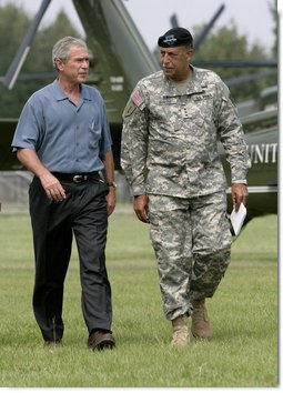 President George W. Bush and U.S. Army Lt General Russel Honore walk to the Emergency Operations Center, Monday, Sept. 5, 2005, after the President's arrival in Baton Rouge, La.  White House photo by Eric Draper