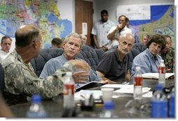 President George W. Bush receives a briefing from U.S. Army Lt. General Russel Honore, left, inside the Emergency Operations Center in Baton Rouge, La., Monday Sept. 5, 2005, as Homeland Security Secretary Michael Chertoff, second from right, and Louisiana Governor Kathleen Blanco, right, join the meeting. White House photo by Eric Draper