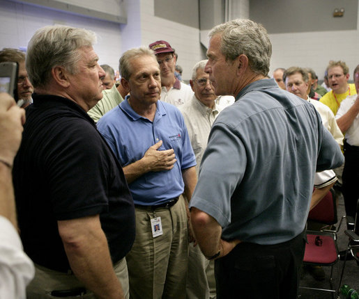 President George W. Bush talks with Mississippi Governor Haley Barbour, far left, and other state officials in Poplarville, Miss., during a visit Monday, Sept. 5, 2005 to the Gulf Coast region. White House photo by Eric Draper