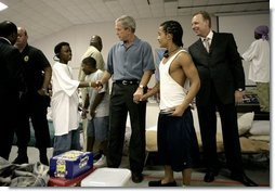 President George W. Bush visits with children inside the Bethany World Prayer Center shelter, Monday, Sept. 5, 2005 in Baton Rouge, Louisiana. The facility is housing hundreds of people displaced by Hurricane Katrina.  White House photo by Eric Draper