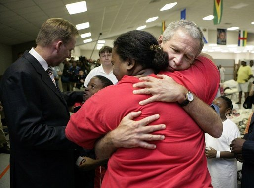 President George W. Bush hugs a woman displaced by Hurricane Katrina during his visit Monday, Sept. 5, 2005 at the Bethany World Prayer Center shelter in Baton Rouge, La. White House photo by Eric Draper