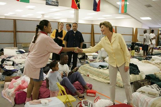 Laura Bush visits people affected by Hurricane Katrina at the Bethany World Prayer Center shelter, Monday, Sept. 5, 2005 in Baton Rouge, Louisiana, where hundreds of people have taken refuge. White House photo by Krisanne Johnson