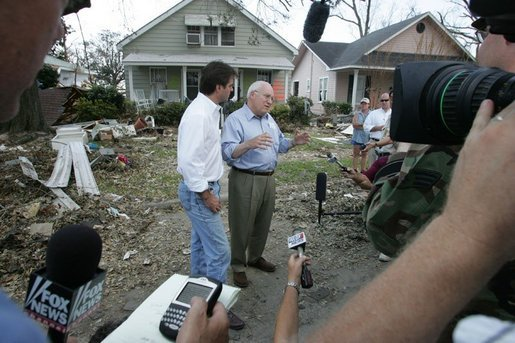 Vice President Dick Cheney walks with Mayor Brent Warr, Thursday, Sept. 8, 2005, through a neighborhood in Gulfport, Miss., devastated by Hurricane Katrina, as they talk with surviving residents. White House photo by David Bohrer