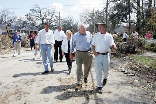 Vice President Dick Cheney walks with a resident of a Gulfport, Mississippi neighborhood Thursday, September 8, 2005. The area was damaged by Hurricane Katrina, which hit both Louisiana and Mississippi on August 29th. Mrs. Cheney and Mayor Brent Warr are also shown walking. White House photo by David Bohrer