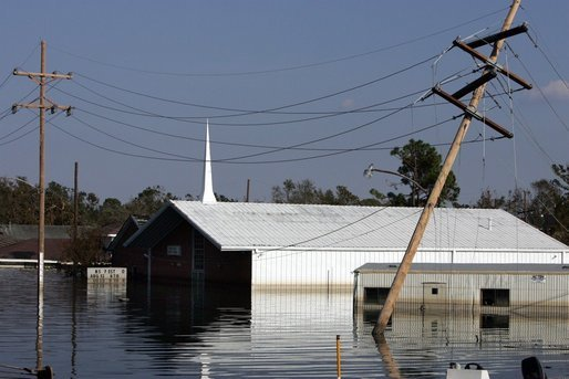 A church in New Orleans, Louisiana is submerged by floodwaters that were caused by the effects of Hurricane Katrina Thursday, September 8, 2005. The hurricane hit both Louisiana and Mississippi on August 29th. White House photo by David Bohrer