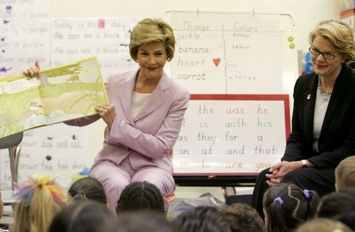 Laura Bush is joined by U.S. Education Secretary Margaret Spellings, right, as she reads a book to first graders at Lovejoy Elementary School in Des Moines, Iowa, Thursday, September 8, 2005. White House photo by Krisanne Johnson