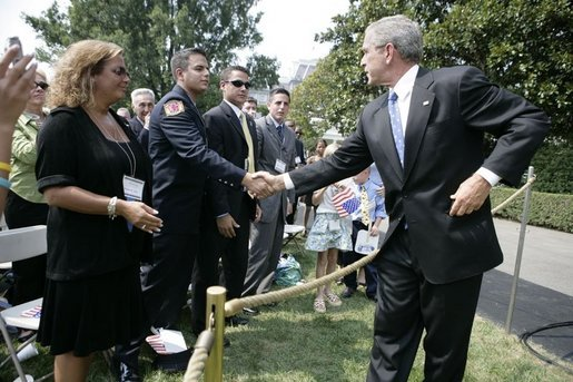 President George W. Bush shakes hands Friday, Sept. 9, 2005 with FDNY Academy graduate Tommy Gies, son of New York firefighter Lt. Ronnie Gies who died on 9/11/01, following the President's remarks at the 9/11 Heros Medal of Valor Award Cermony on the South Lawn of the White House in Washington. Gies, seen with his mother and brothers, told the President in an earlier meeting in March 2004 that it was his wish to follow in his father's footsteps. White House photo by Eric Draper