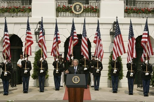 President George W. Bush gestures as he addresses guests on the South Lawn of the White House, Friday, Sept. 9, 2005, during the 9/11 Heroes Medal of Valor Award Ceremony and to honor the courage and commitment of emergency services personnel who died on Sept. 11, 2001. White House photo by Paul Morse