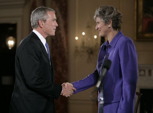 President George W. Bush congratulates Karen Hughes after her swearing-in by U.S. Secretary of State Condoleezza Rice, Friday, Sept. 9, 2005 at the State Department in Washington, to be the Under Secretary of State for Public Diplomacy. White House photo by Eric Draper