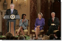 President George W. Bush addresses an audience attending the swearing-in ceremony of Karen Hughes, Friday, Sept. 9, 2005 at the State Department in Washington, to be the Under Secretary of State for Public Diplomacy. Karen Hughes is seen with U.S. Secretary of State Condoleezza Rice and her husband Jerry Hughes. White House photo by Paul Morse