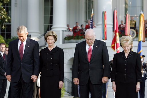 President Bush stands with Laura Bush, Vice President Dick Cheney and Mrs. Cheney as they observe a moment of silence, on the South Lawn, in honor of 9/11 victims September 11, 2005. This marks the fourth anniversary of terrorist attacks on both the World Trade Center and The Pentagon. White House photo by Krisanne Johnson