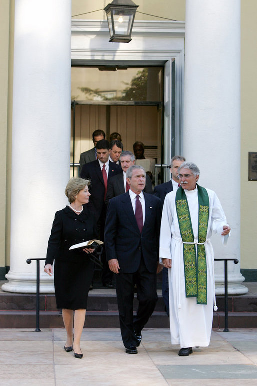President Bush and First Lady Laura Bush walk with Rev. Luis Leon after attending a Service of Prayer and Remembrance for 9/11 victims at St. John's Episcopal Church in Washington, DC, September 11, 2005. This marks the fourth anniversary of terrorist attacks on both the World Trade Center and The Pentagon. White House photo by David Bohrer