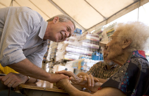 President George W. Bush visits people at a hurricane assistance center in Gulfport, Miss., Monday, Sept. 12, 2005. White House photo by Paul Morse