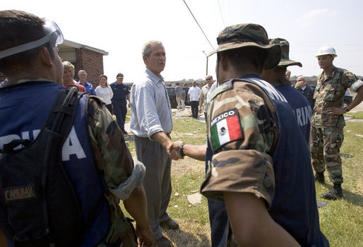 President George W. Bush greets aid workers from Mexico helping in the hurricane ravaged areas in Gulfport, Miss., Monday, Sept. 12, 2005. White House photo by Paul Morse