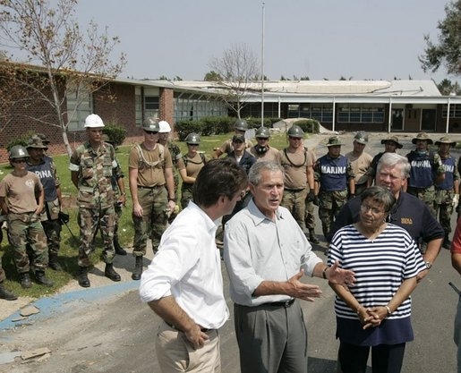 President George W. Bush is joined by Gulfport, Miss., Mayor Brent Warr, left; Twenty-Eighth Street Elementary School principal Phyllis A Bourn and Mississippi Gov. Haley Barbour, right, Monday, Sept. 12, 2005, outside the Twenty-Eighth Street Elementary School in Gulfport, where U.S. and Mexico aid workers are helping to clean-up the school devastated by Hurricane Katrina. White House photo by Paul Morse