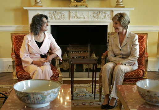 Laura Bush visits with Mrs. Hero Ibrahim Ahmed, wife of Iraqi President Jalal Talabani, during a tea in the private residence of the White House Monday, Sept. 12, 2005. White House photo by Krisanne Johnson