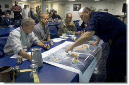 President George W. Bush, joined by New Orleans Mayor C. Ray Nagin, is given a briefing by U.S. Army Lt. General Russel L. Honore and U.S. Coast Guard Vice Admiral Thad W. Allen, Monday, Sept. 12, 2005 at the operations center in New Orleans, La. White House photo by Paul Morse