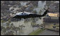 President George W. Bush flies over the hurricane ravaged neighborhoods of New Orleans, La., in Marine One, Monday, Sept. 12, 2005. White House photo by Paul Morse