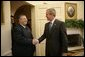 President George W. Bush welcomes President Jalal Talabani of Iraq into the Oval Office, Tuesday, Sept. 13. 2005 at the White House in Washington. White House photo by Eric Draper