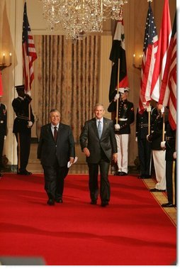 "President George W. Bush and President Jalal Talabani of Iraq walk to the East Room of the White House Tuesday, Sept. 13, 2005, for a joint press availability. The President called Iraq ""America's ally in the war against terrorism,"" and added, ""freedom will win in Iraq.""  White House photo by Shealah Craighead"