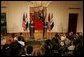 President George W. Bush and Iraq's President Jalal Talabani face the press during a joint availability Tuesday, Sept. 13, 2005, in the East Room of the White House. White House photo by Shealah Craighead
