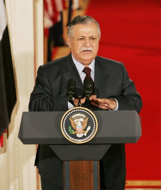 "President Jalal Talabani of Iraq, speaks to the media during a joint press availability Tuesday, Sept. 13, 2005, in the East Room of the White House. ""It is an honor for me to stand here today as a representative of free Iraq,"" the President said. ""It is an honor to present the world's youngest democracy."" White House photo by Shealah Craighead"