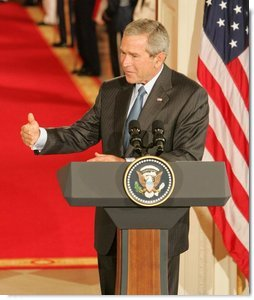"President George W. Bush speaks during an availability Tuesday, Sept. 13, 2005, with Iraq's President Jalal Talabani. Said the President, ""It's an honor to welcome the first democratically elected President of Iraq to the White House.""  White House photo by Shealah Craighead"