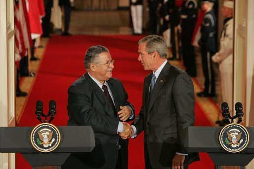 President George W. Bush shakes hands with President Jalal Talabani of Iraq after their joint press availability Tuesday, Sept. 13, 2005, in the East Room of the White House. White House photo by Shealah Craighead