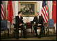 President George W. Bush and President Hu Jintao of China greet each other at the start of their meeting, Tuesday, Sept. 13, 2005, in New York. White House photo by Eric Draper
