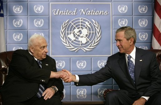 President George W. Bush and Prime Minster Ariel Sharon of Israel greet each other during their meeting at the United Nations in New York, Wednesday, Sept. 14, 2005. White House photo by Eric Draper