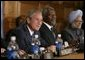President George W. Bush, UN Secretary General Kofi Annan, center, and Prime Minister Manmohan Singh of India, far right, attend the meeting of the International Launch of the United Nations Democracy Fund in New York Wednesday, Sept. 14, 2005. White House photo by Eric Draper