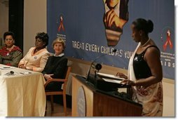 Laura Bush listens to Jeannette Kagame, the First Lady of Rwanda and President of the Organization of African First Ladies Against HIV/AIDS, addresses the group in New York Thursday, Sept. 15, 2005.  White House photo by Krisanne Johnson