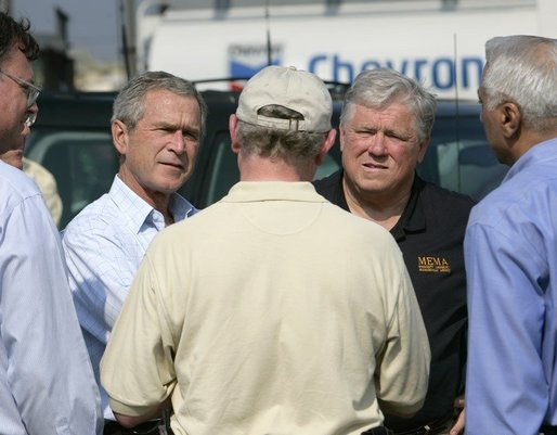 President George W. Bush receives a briefing from Chevron Refinery Manager Roland Kell with Mississippi Governor Haley Barbour at the Chevron Pascagoula Refinery in Mississippi, Thursday, Sept. 15, 2005. White House photo by Eric Draper