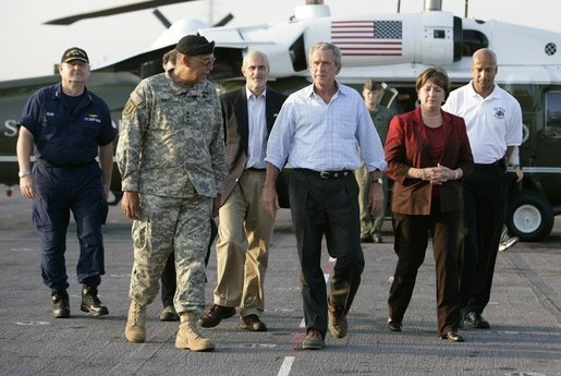 President George W. Bush arrives on the deck of the USS Iwo Jima escorted by General Russel Honore in New Orleans, La., Thursday, Sept. 15, 2005. White House photo by Eric Draper