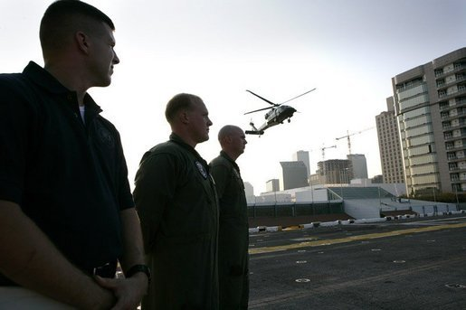 President George W. Bush aboard Marine One lands on the deck of the USS Iwo Jima during his arrival in New Orleans, La., Thursday, Sept. 15, 2005. White House photo by Eric Draper