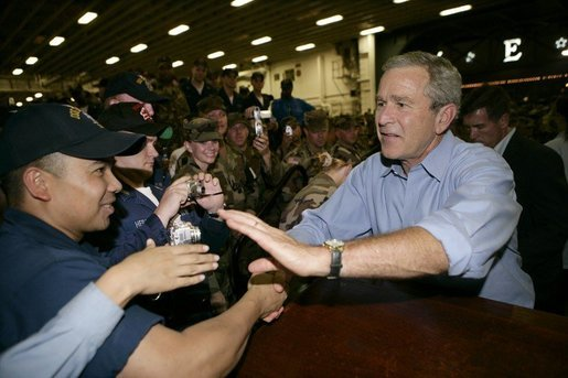 President George W. Bush greets sailors aboard the USS Iwo Jima after delivering remarks on hurricane recovery efforts during an Address to the Nation in New Orleans, La., Thursday, Sept. 15, 2005. White House photo by Eric Draper