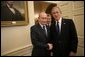 President George W. Bush welcomes Russian President Vladimir Putin into the Oval Office at the White House, Friday, Sept. 16, 2005 in Washington. White House photo by Eric Draper
