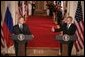 President George W. Bush and Russian President Vladimir Putin appear together at a joint news conference in the East Room of the White House, Friday, Sept. 16, 2005 in Washington, where President Bush thanked Putin for Russia's offers of assistance in the wake of Hurricane Katrina. White House photo by Eric Draper